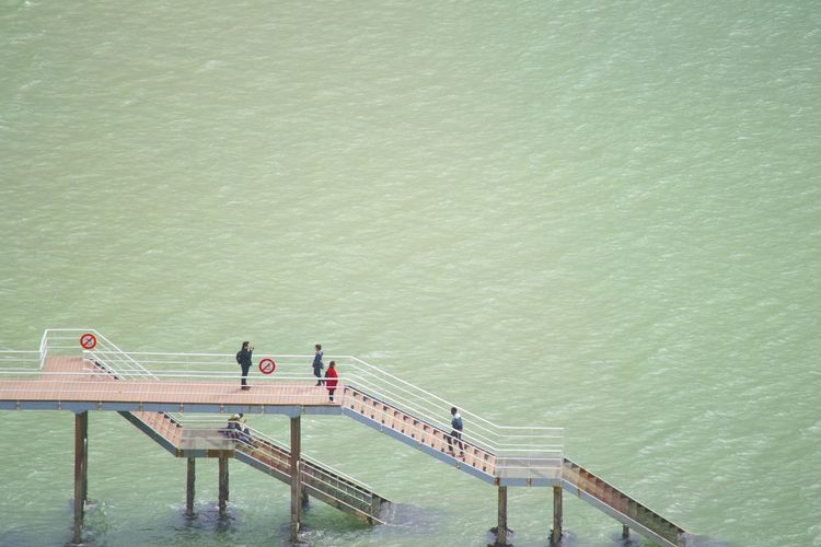 High angle view of tourists on pier