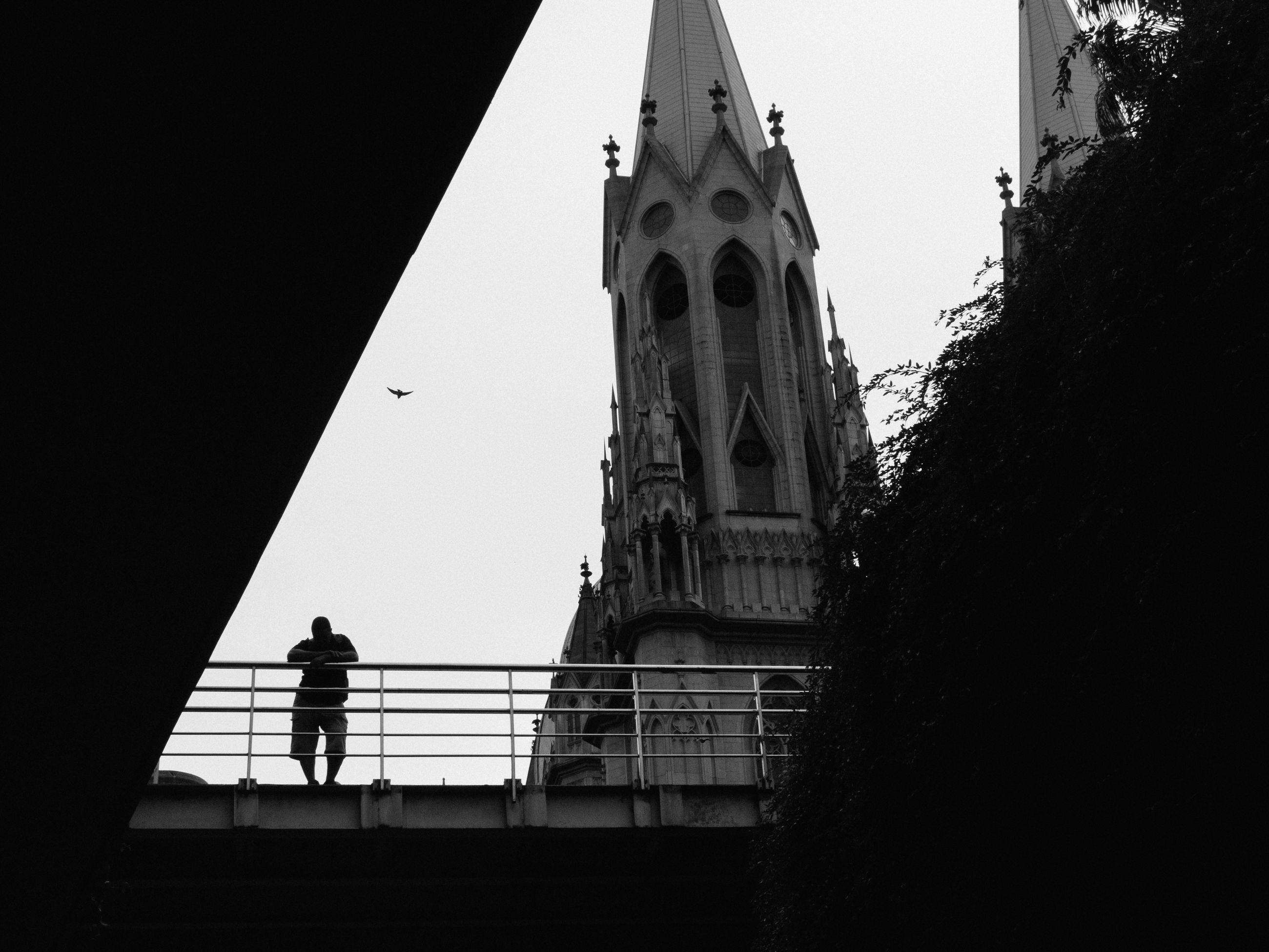 architecture, built structure, building exterior, men, lifestyles, church, walking, low angle view, person, place of worship, religion, steps, full length, standing, clear sky, silhouette, railing