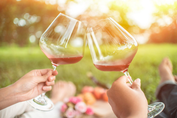 Alcohol Body Part Celebration Celebratory Toast Drink Finger Focus On Foreground Food And Drink Friendship Glass Group Of People Hand Holding Human Body Part Human Hand Lifestyles Outdoors People Real People Red Wine Refreshment Wine Wineglass Women