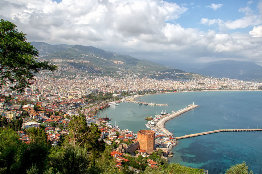 View of Alanya Alanya Mediterranean  Mediterranean Sea Turkey Architecture Bay Beauty In Nature Building Exterior Built Structure Castle Walls Cityscape Cloud - Sky High Angle View Mountain Nature Nautical Vessel Port Red Tower Ruins Architecture Sea Sky Tourist Destination Transportation Travel Destinations Water