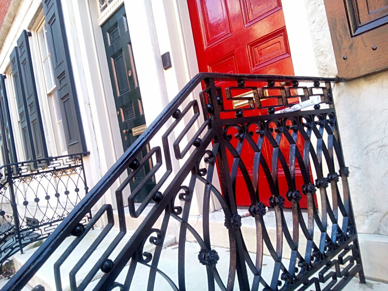 railing, architecture, built structure, staircase, red, steps, no people, residential building, building exterior, day, outdoors