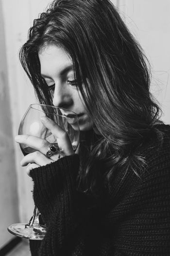 dark woman posing in a black and white portrait while she is drinking wine One Person Young Adult Real People Leisure Activity Indoors  Refreshment Drinking Lifestyles Holding Young Women Women Drink Portrait Headshot Beautiful Woman Hair Hairstyle Adult Glass Long Hair Wine Wineglass Glamour