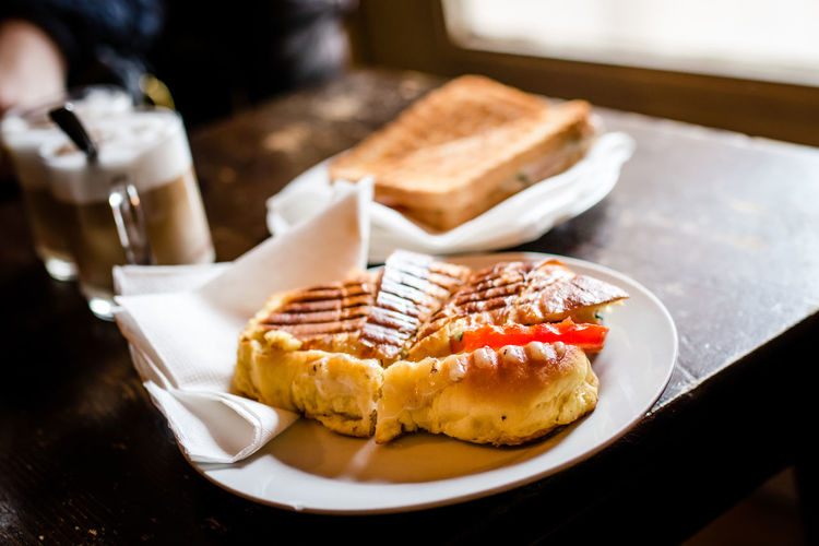 High angle view of sandwich in plate on table at restaurant