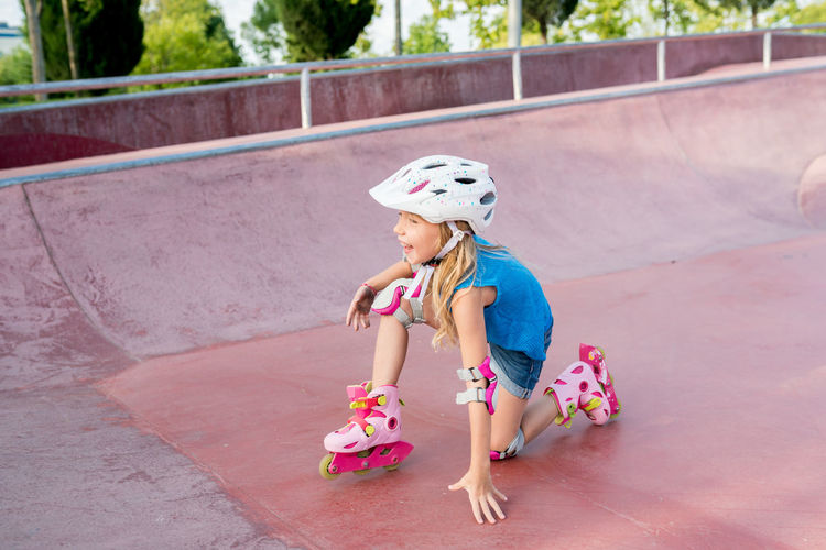 Full length of cute girl inline skating at park