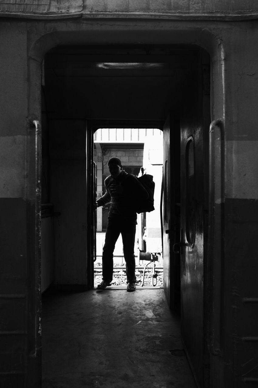 Full length of man standing at train doorway