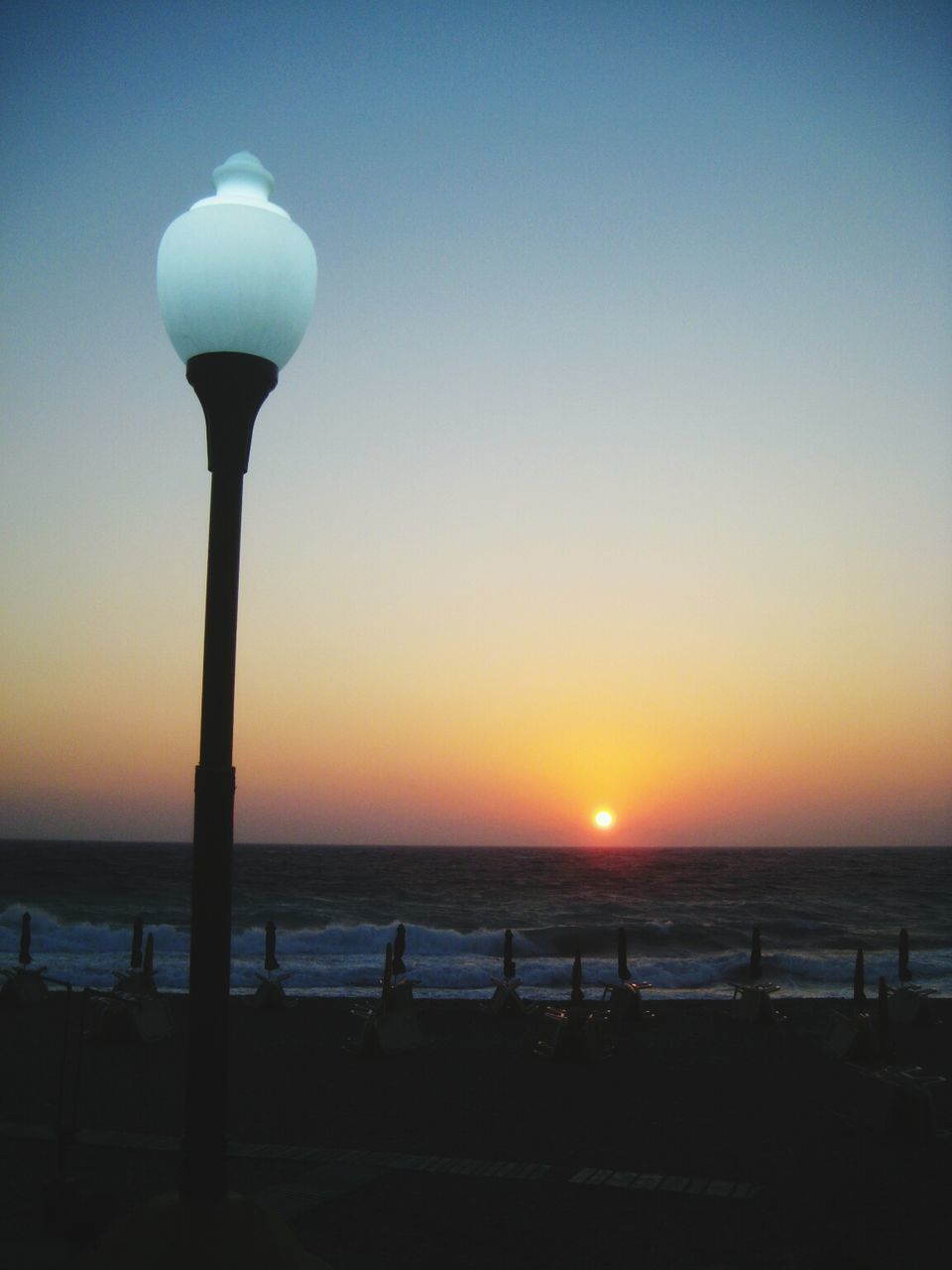 sunset, sea, beach, sun, lighting equipment, silhouette, nature, scenics, outdoors, beauty in nature, water, no people, horizon over water, tranquility, sky, illuminated