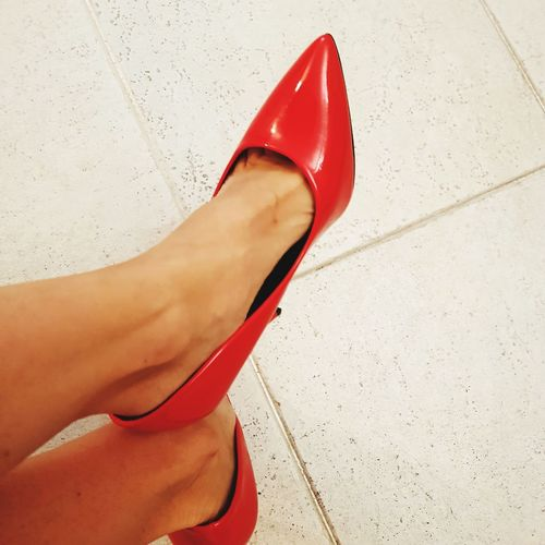 Low section of woman wearing high heels