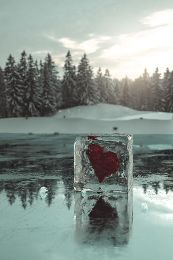 Frozen Heart Shape In Lake Against Sky During Winter