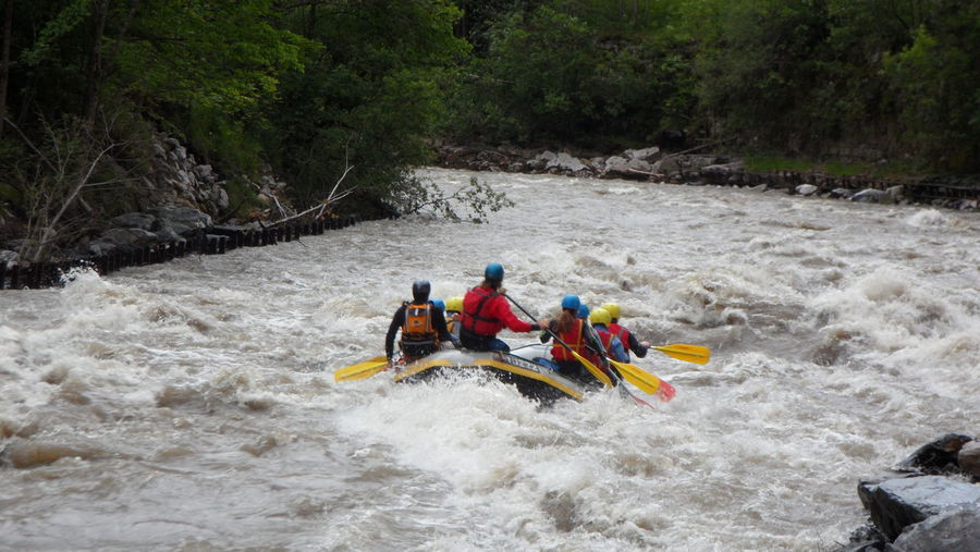 People rafting in river