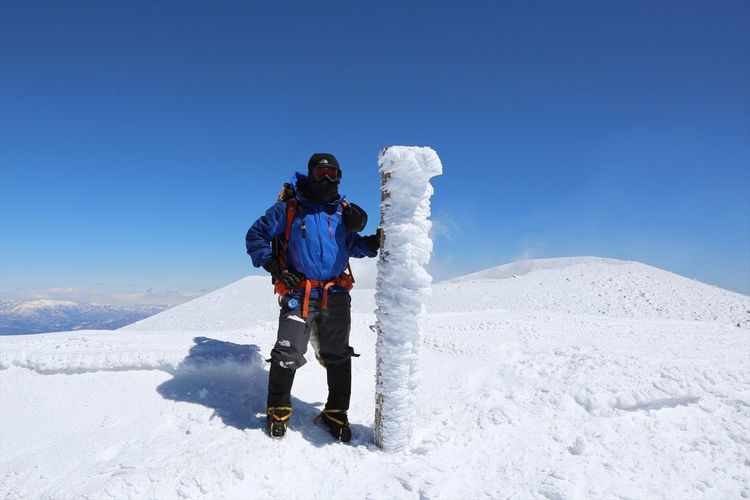 Full Length Of Man Standing On Mt Asama Against Clear Blue Sky During Sunny Day
