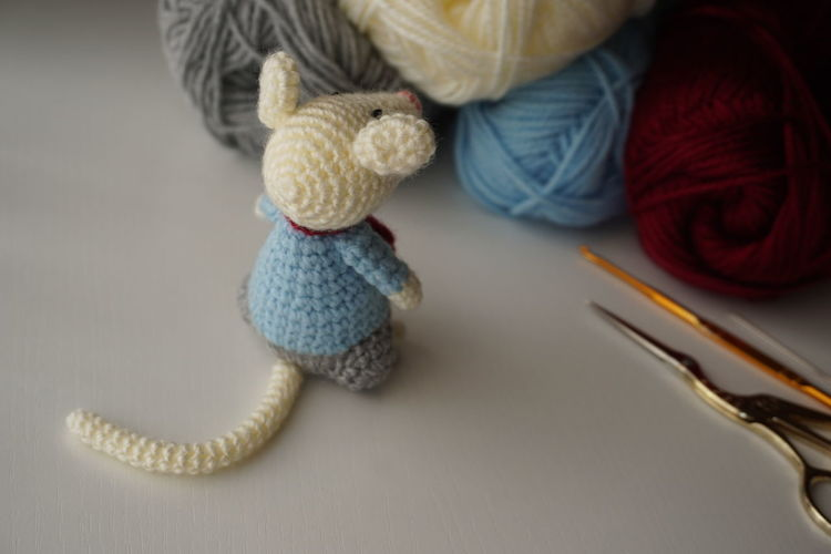 Close-Up Of Knitted Wool Doll On Table