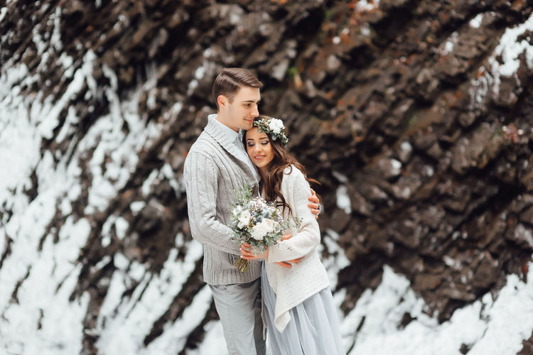 Young couple standing on rock