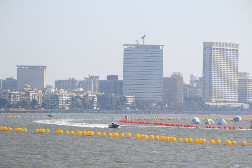 CityBoat Water Sports Power Boats Race Boat Race  Sea Business Finance And Industry Nautical Vessel Sports Race Boats Skyscraper Building Exterior Architecture Cityscape No People Urban Skyline Outdoors Day