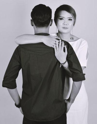 More Than I Need You Couple Husband INDONESIA Love Arm Around Couple - Relationship Front View Heterosexual Couple Looking At Camera Men Portrait Prewedding Real People Standing Studio Shot Teenage Boys Teenager Two People Wife Young Men