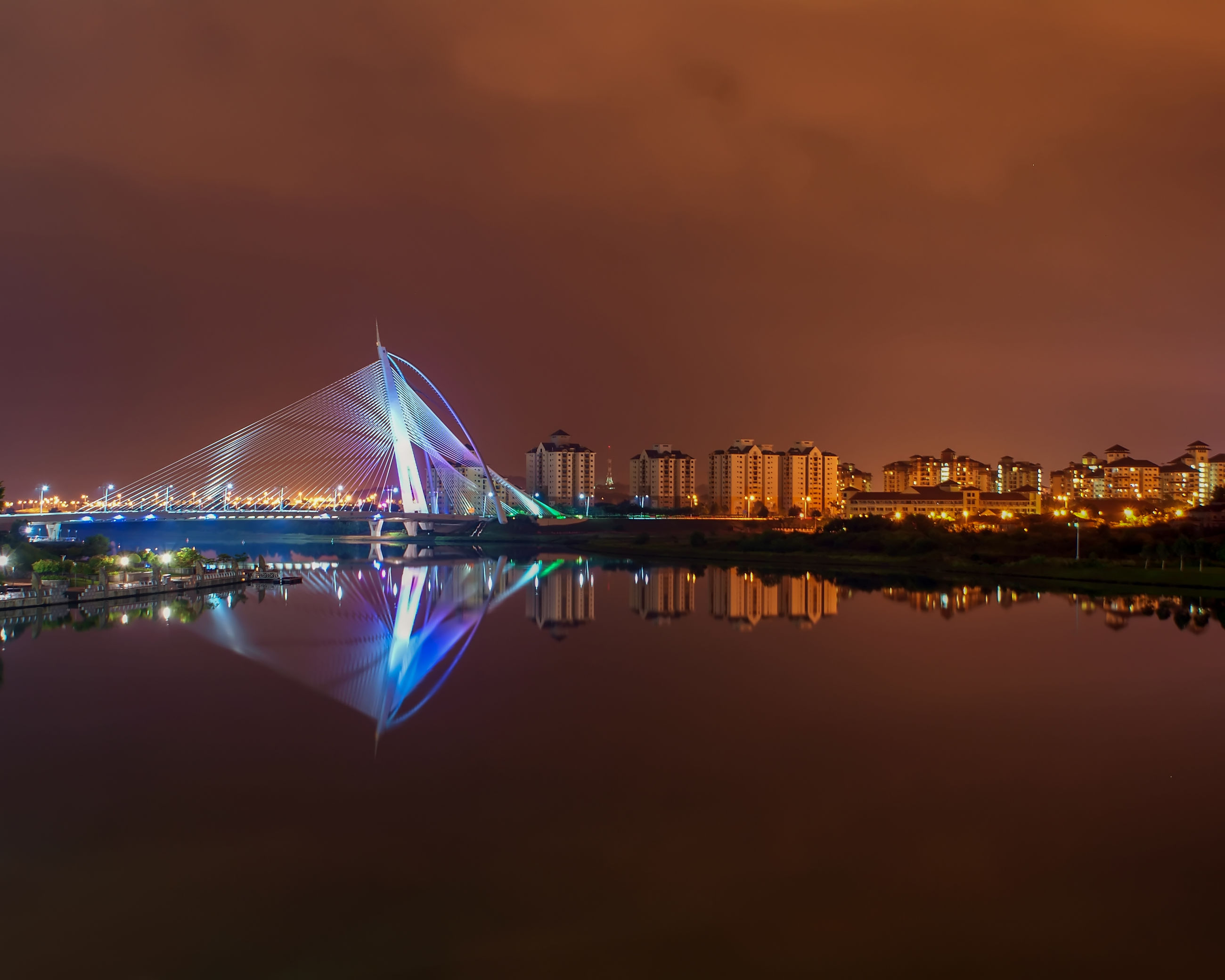 reflection, water, architecture, sky, waterfront, building exterior, built structure, illuminated, no people, night, city, nature, building, river, travel destinations, sunset, symmetry, long exposure, beauty in nature, outdoors, cityscape