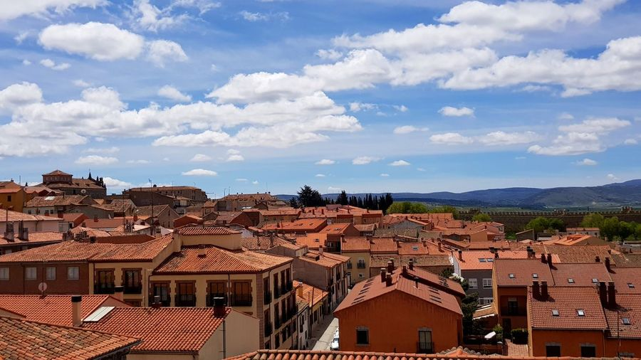 Avila EyeEm Selects Cityscape Sky Architecture Roof Tile TOWNSCAPE Tiled Roof  Old Town Bell Tower Townhouse Town Human Settlement Residential Structure Residential District Housing Settlement Rooftop Roof Settlement King - Royal Person
