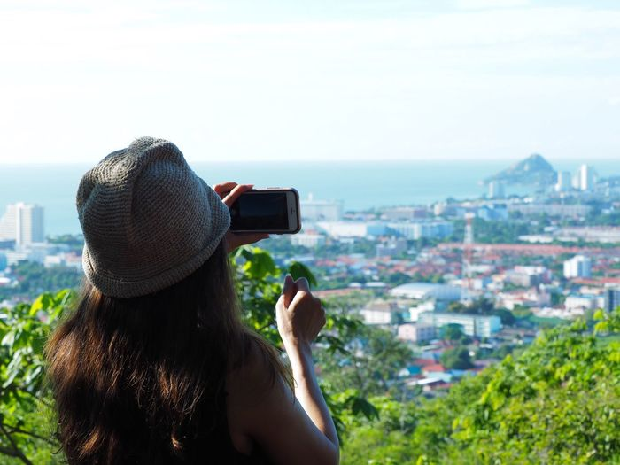 Hin Lek Fai Viewpoint at Hua Hin, Thailand Rear View Real People Technology Photography Themes Photographing Women Architecture Leisure Activity Lifestyles Wireless Technology Built Structure Holding Camera - Photographic Equipment Building Exterior One Person Day Sea Outdoors Digital Single-lens Reflex Camera Modern Beauty In Nature Background Clear Sky Shot Landscape Live For The Story Place Of Heart
