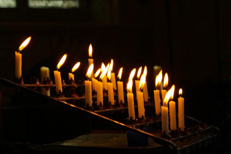 Close-Up Of Illuminated Candles At Church