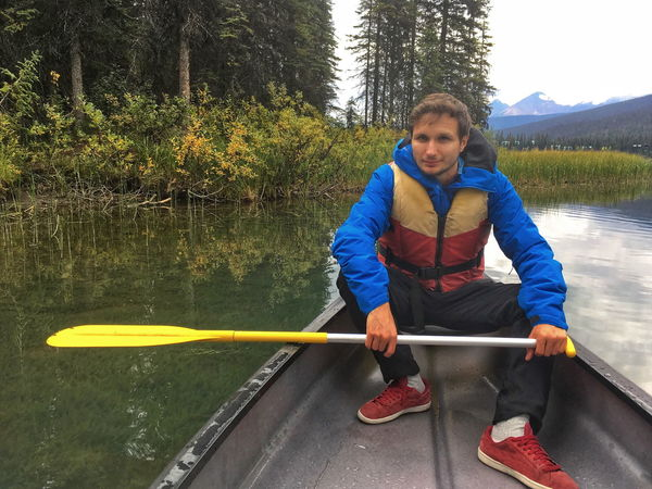 Emerald lake, Canada Canoe Man Activity Adventure Day Front View Handsome Lake Leisure Activity Lifestyles Looking At Camera Mode Of Transportation Nature Nautical Vessel Oar One Person Outdoors Plant Real People Sitting Transportation Tree Water Young Adult