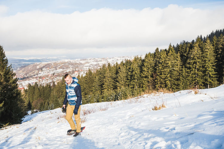 Snowy yet sunny winter days One Person Full Length Cloud - Sky Real People Leisure Activity Sky Snow Beauty In Nature Nature Day Winter Cold Temperature Scenics - Nature Outdoors Slide Sliding Board Slide Slide Board Pine Trees Warm Clothing Sport Activity Holiday Mountain Slope