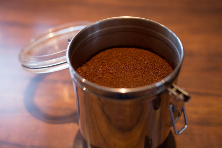 Close-Up Of Ground Coffee In Jar On Table