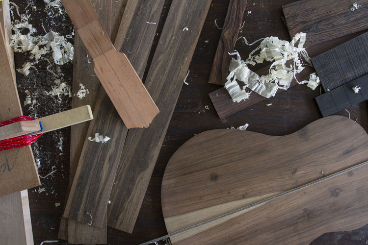 High angle view of wooden planks on table at carpentry workshop
