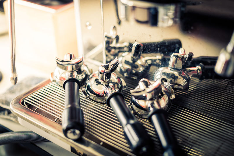 Close-Up Of Portafilters On Coffee Machine