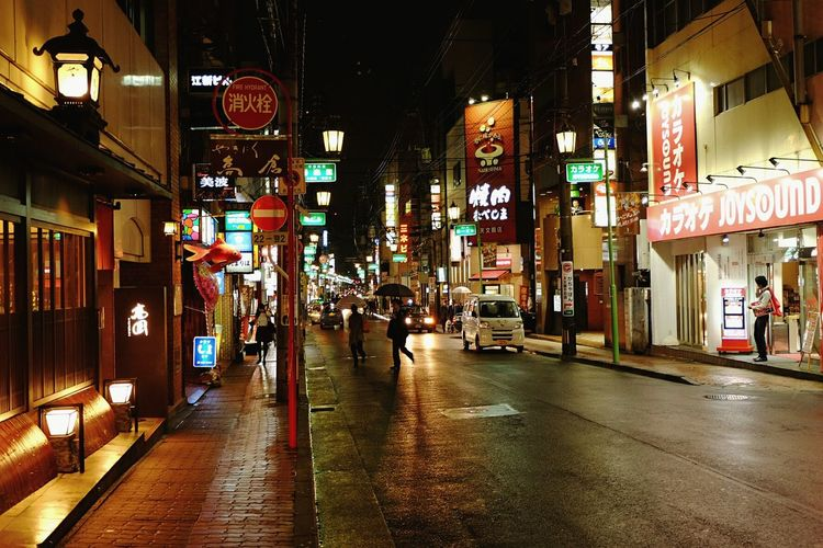 Observing the streets Taking Photos Streetphotography Street Candid Candid Photography Rain Nihon Rainy Days☔ Nightshot Travel Japan Kagoshima City Life City By Night Cities At Night Ultimate Japan
