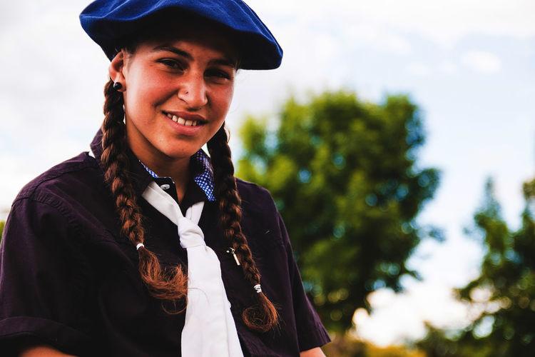 Portrait of smiling teenage girl wearing beret
