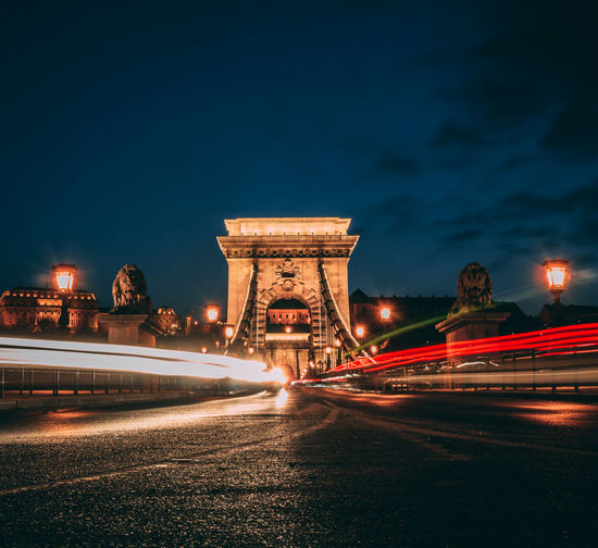 Light trails on szechenyi chain bridge against sky at night