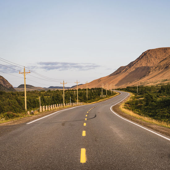 Twisting road running beside the Tablelands in the Gros Morne National Park in Newfoundland, Canada Road Nature No People Asphalt Outdoors Newfoundland Canada Tablelands Curve Twisting Rural Wilderness Park Geology Travel Mountain Empty Road Desert Golden Hour Bends Rugged Summer