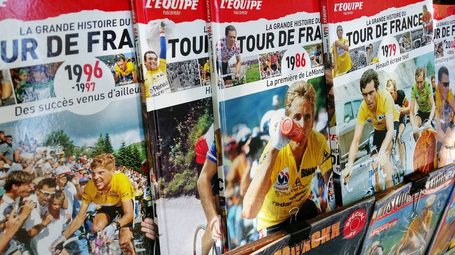 Old L'équipe  Magazines featuring stories about Tour De France are sold on the left side of Seine in Paris. Cycling Vintage Sport Cycling Race Press Covers