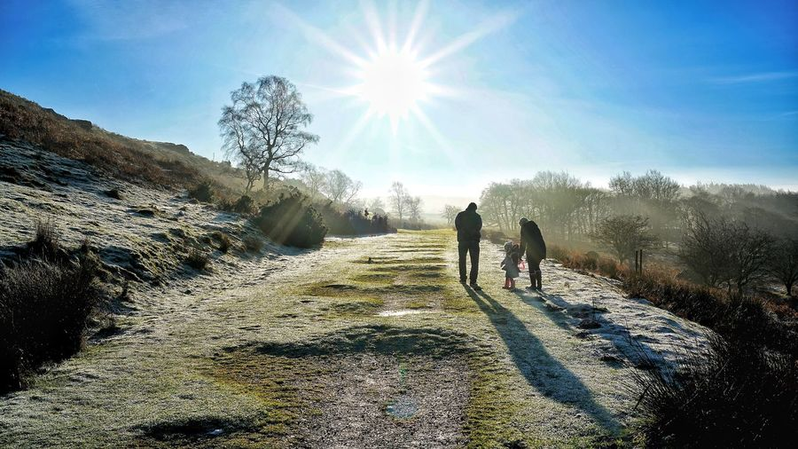 Family walking in the winter ! Bright Outdoors People Scenics - Nature Two People Full Length Plant Sunny Rear View Day Beauty In Nature Walking Lens Flare Leisure Activity Lifestyles Sun Nature Real People Men Sky Silhouette Sunlight Enjoying Life Family Time Sunbeam Wintertime Pathway Frosty Mornings Wintertime In The Country Peak District Northern England Path In Nature Frosty Fields Silhouette Of People Derbyshire Dales Derbyshire Countryside Frosty Path Person Hiking Silhouette Of Family