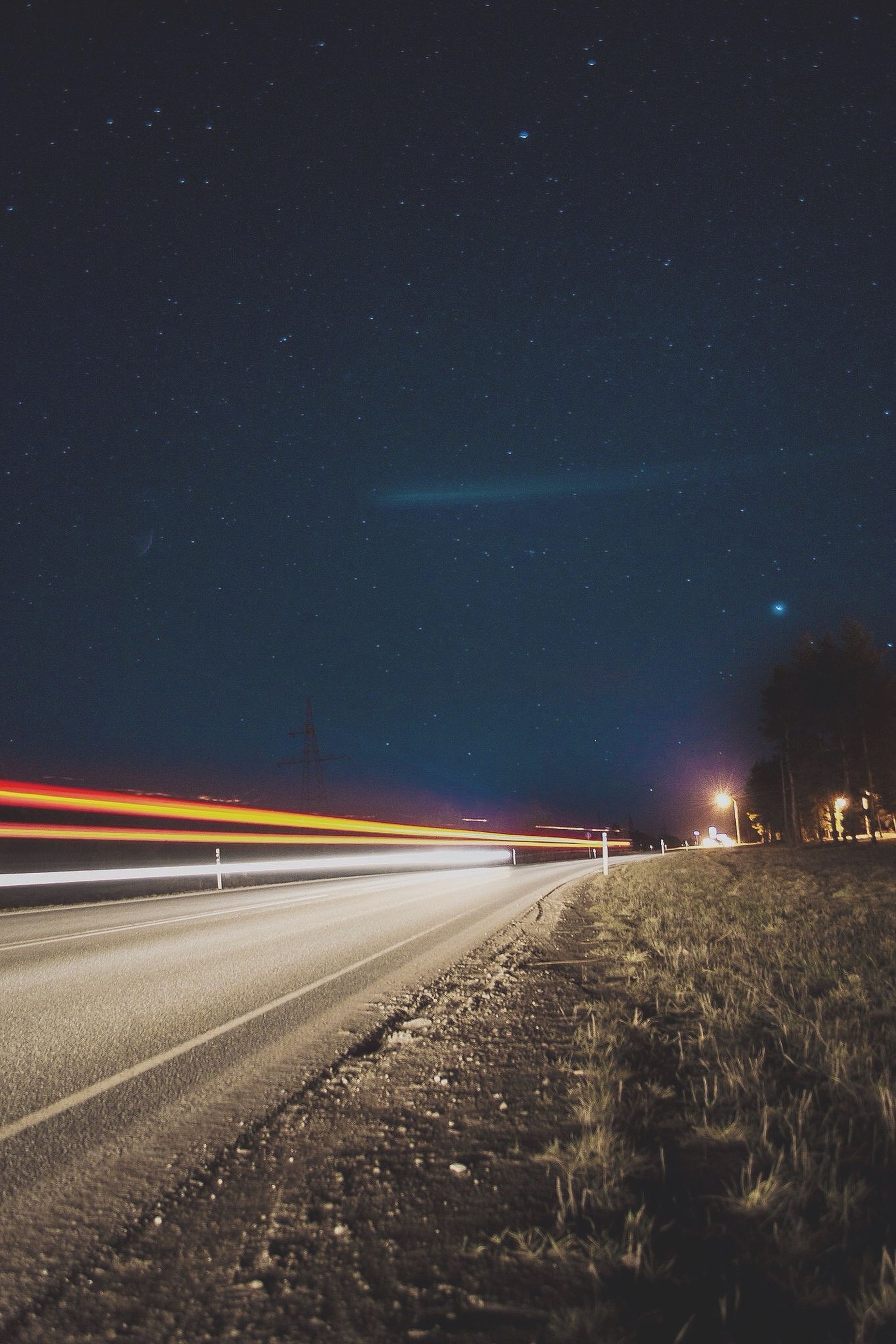 night, illuminated, road, star - space, transportation, sky, scenics, tranquil scene, landscape, long exposure, astronomy, tranquility, star field, nature, infinity, beauty in nature, light trail, galaxy, speed, the way forward