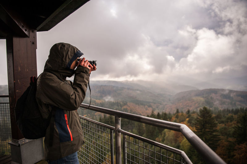 Side View Of Man Photographing While Standing At Observation Point