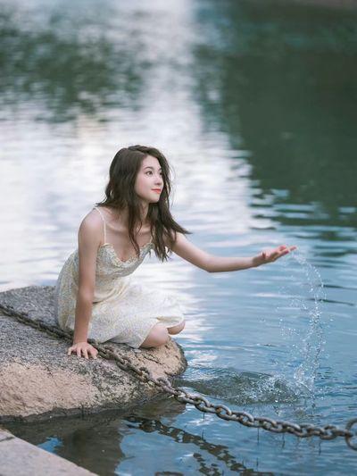 Portrait of woman against lake