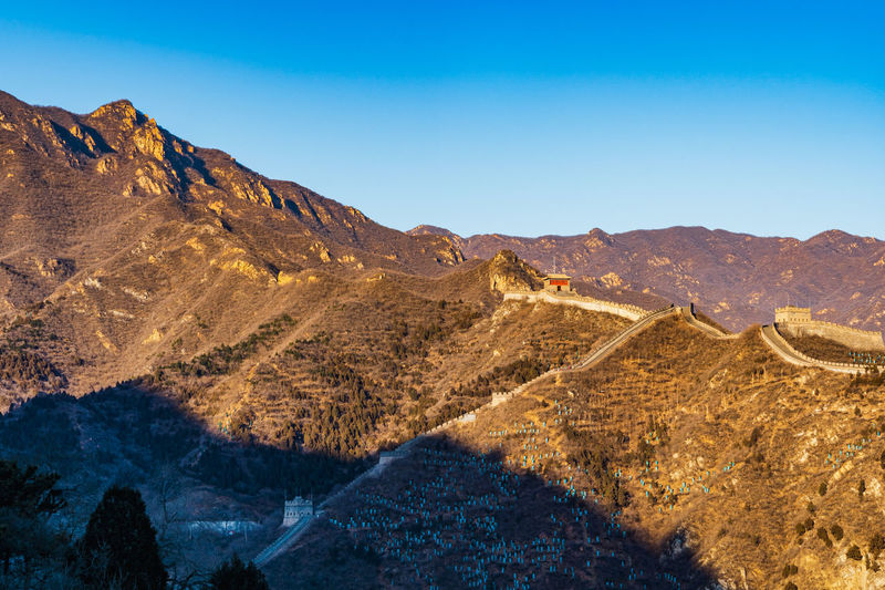 The great wall. scenic view of mountains against clear blue sky