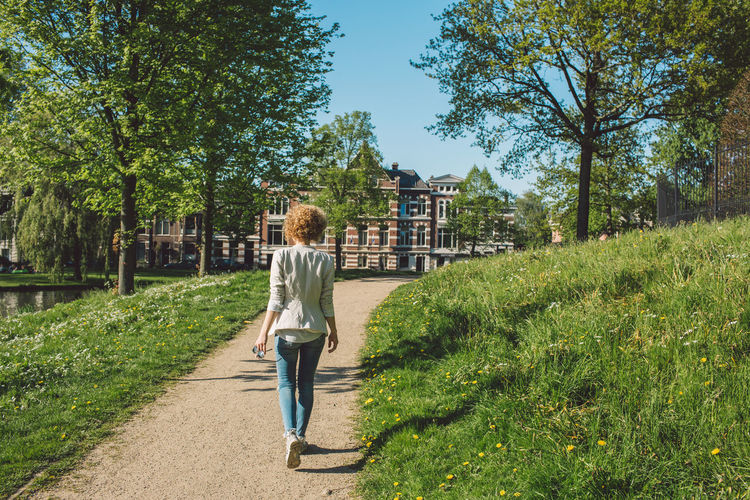 Full length of woman walking on pathway at park