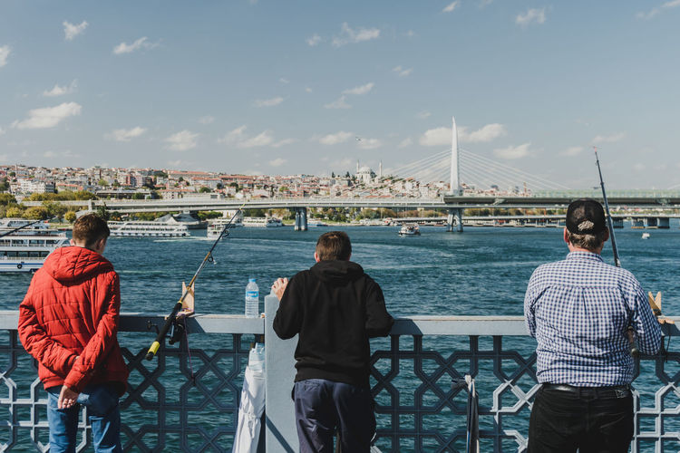 Fishermen, young and old, overlooking Istanbul on a summer day waiting for a catch. - IG: @LostBoyMemoirs - IG: @LostBoyMemoirs Streetwise Photography Steetphotography Street Photography The Week on EyeEm Best EyeEm Shot My Best Photo People People Watching People Photography people and places Fishing Fisherman Fishermen The Art Of Street Photography