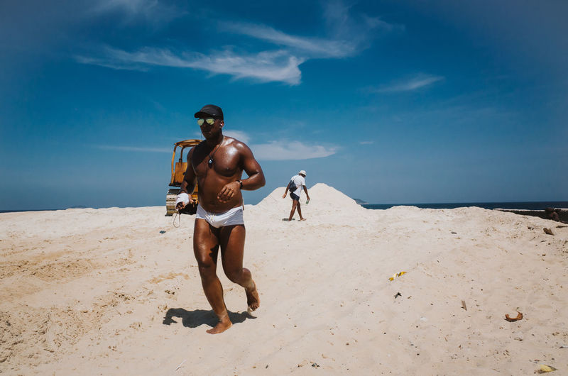 Black Jogger at the beach Sportsman Sports Fitness Healthy Lifestyle Jogging Running Documentary Photography Brazil Rio De Janeiro Fun Cool Hot Weather Leisure Sand Dune Full Length Desert Sand Men Clear Sky Arts Culture And Entertainment Portrait Sky Arid Climate Arid