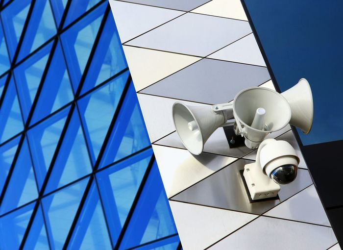 Low angle view of megaphones on modern building