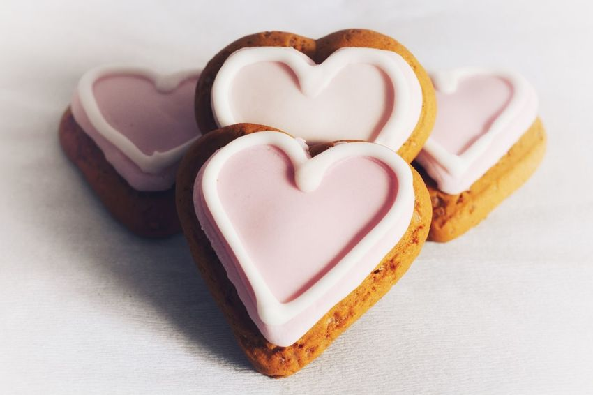 Heart shaped gingerbread cookies with pink and white icing. Copy Space Romance Pink Hearts Biscuits Valentine's Day  Love Romantic Heart Shape Love Food And Drink Still Life Food Sweet Food Shape No People Freshness Indoors  Close-up Cookie Ready-to-eat White Background Day