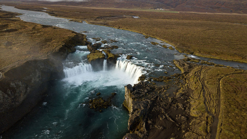 The Goðafoss is a waterfall in Iceland. It is located in the Bárðardalur district of Northeastern Region at the beginning of the Sprengisandur highland road. The water of the river Skjálfandafljót falls from a height of 12 meters over a width of 30 meters. Scenics - Nature Water Beauty In Nature Waterfall Motion Long Exposure Nature Flowing Water No People Outdoors Power In Nature Flowing Goðafoss Waterfall Sunrise Sunset Rock Rock - Object High Angle View Land Day Aerial View Dronephotography Iceland North Iceland Environment Non-urban Scene Blurred Motion Landscape River