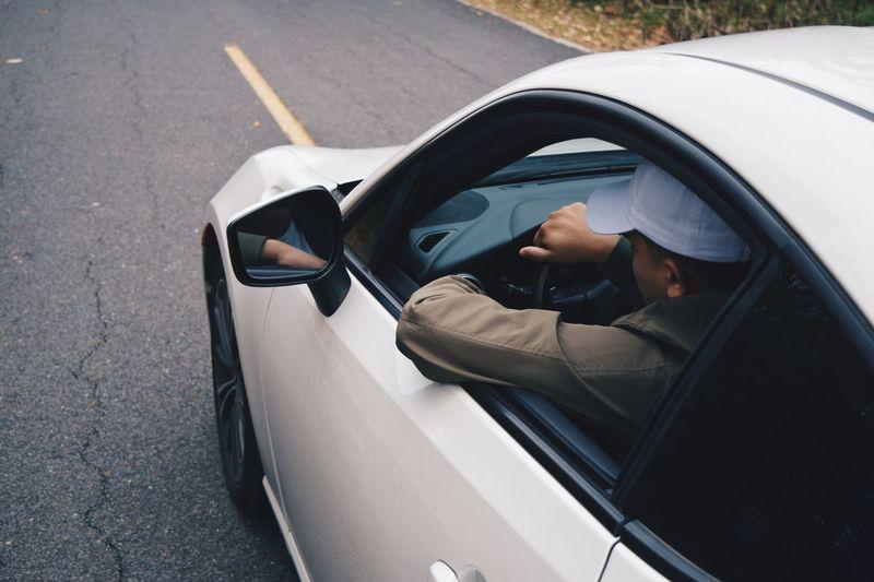 Man driving car on road