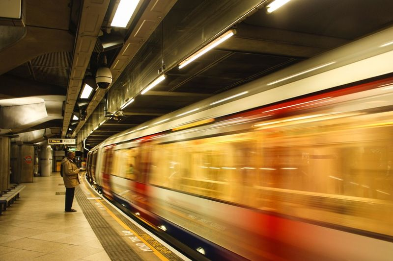 London Underground Architecture Blurred Motion Ceiling Illuminated Incidental People Indoors  Mode Of Transportation Motion on the move Passenger Train Public Transportation Rail Transportation Railroad Station Platform Speed Subway Train Train Train - Vehicle Transportation Travel