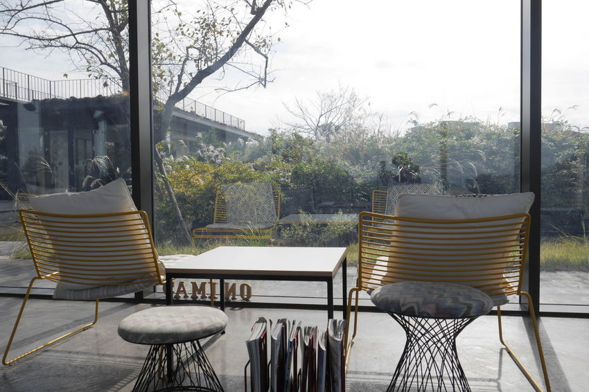 Architecture Building Exterior Built Structure Chair Comfortable Day Front Or Back Yard Nature No People Outdoors Relaxation Residential Building Seat Sky Table Tree