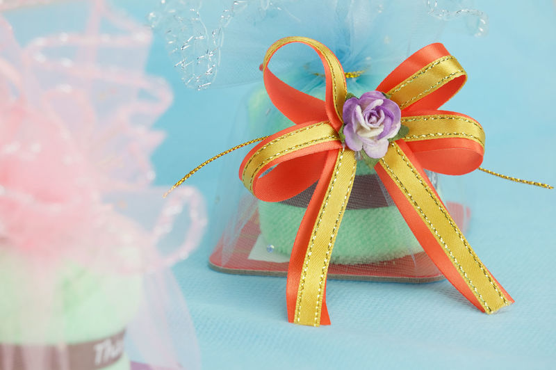 Close-up of christmas presents on blue background