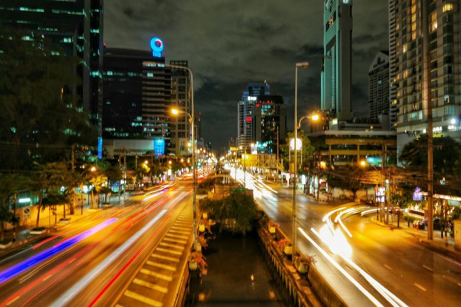 It is a distance away from the heart of the shopping district but the streets of this sprawling Asian metropolis is just as alive and vibrant. Silomroad Bangkok Thailand Eyeemthailand Solotravels Cityscapes Nightscapes City