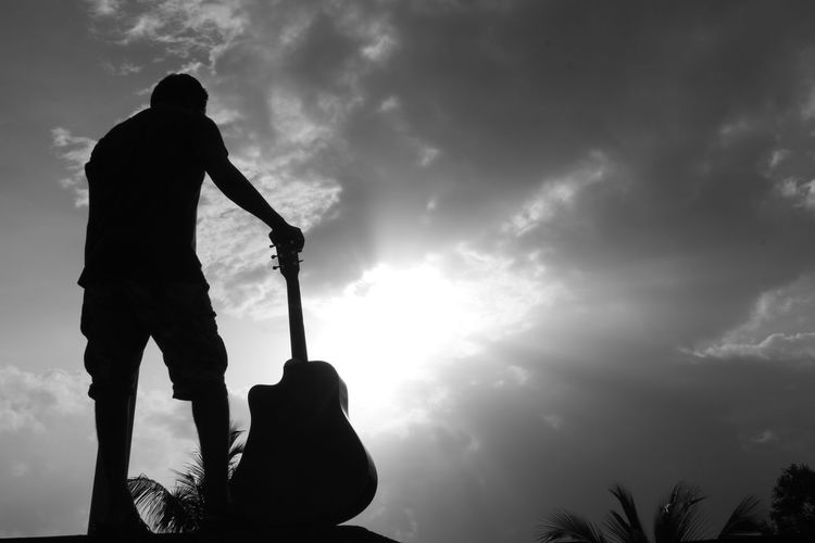 Silhouette One Man Only Adult Cloud - Sky Only Men One Person Lifestyles Adults Only Men Outdoors People Sport Sky Standing Golf Club Tree Day Nature Golf Sportsman Its Me Guitar Black And White Landscape Low Angle View Lost In The Landscape Connected By Travel
