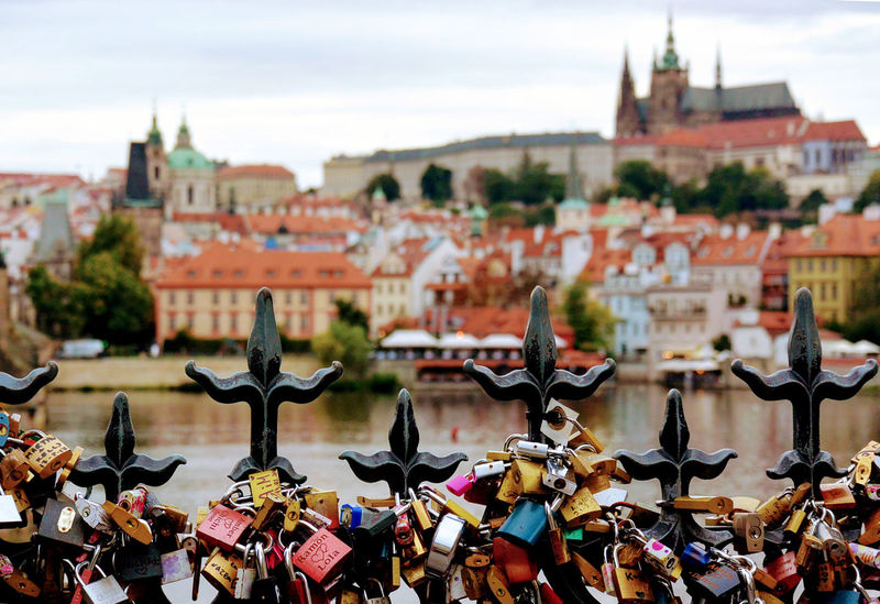Love locks close to charles bridge Church Love Prague River View Riverside Architecture Blurrybackground Built Structure City City Trip Cityscape Day Fence Focus On Foreground History Love Lock Love Locks Lovelocksbridge No People Outdoors Place Of Worship Religion River Sky Travel Destinations